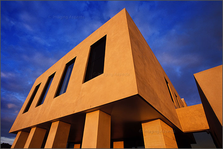 Dramatic camera angle of a sunset lit architect designed residential exterior in Brighton, Victoria.